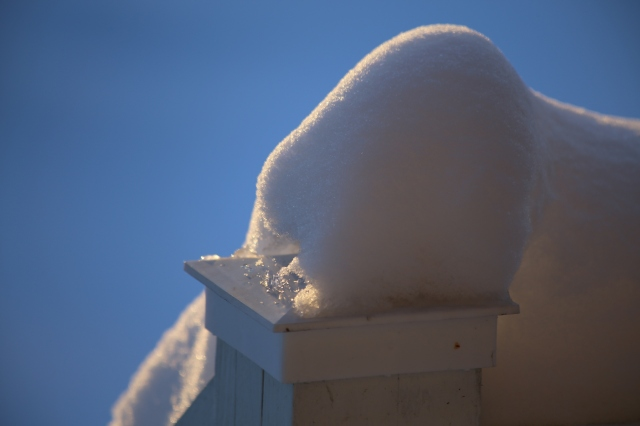 Some accumulated snow on the post at the top of the front staircase ramp at my parent's